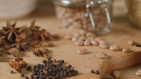 Close-Up-Tracking-Out-Shot-of-Herbs-and-Spices-on-Table