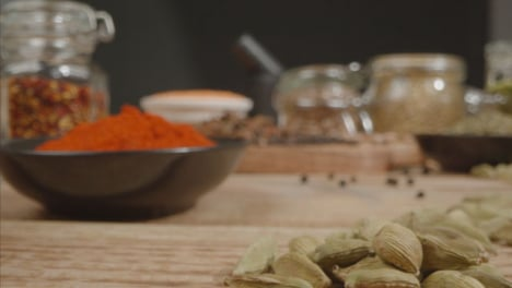 Extreme-Close-Up-Tracking-In-Shot-of-Spices-and-Grains-on-Table