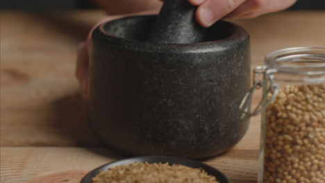 Tracking-In-Shot-from-Cumin-to-Mortar-and-Pestle-on-Table