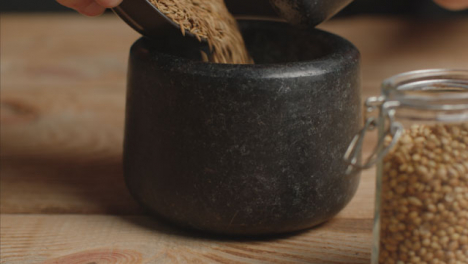 Tracking-In-Shot-with-Cumin-Poured-into-Mortar-and-Pestle