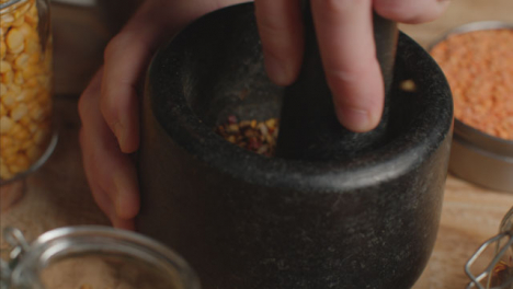 Overhead-Shot-Hand-Using-Mortar-and-Pestle-to-Grind-Spices