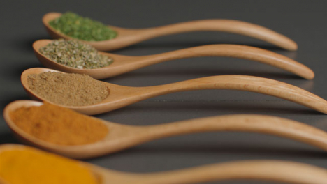Overhead-Tracking-In-Shot-of-Herbs-and-Spices-in-Wooden-Spoons