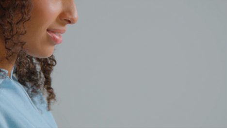 Side-Profile-Shot-of-Young-Adult-Womans-Teeth-Smiling-with-Copy-Space