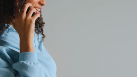Side-Profile-Shot-of-Young-Adult-Woman-Using-Smartphone-with-Copy-Space-01
