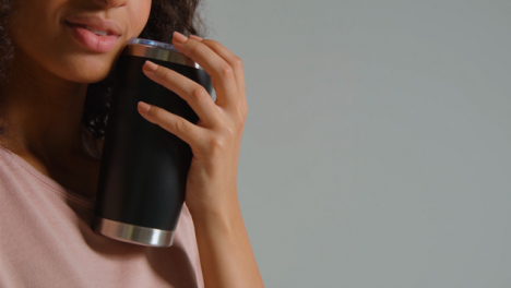 Close-Up-Shot-of-Young-Adult-Womans-Mouth-Drinking-from-Flask-02