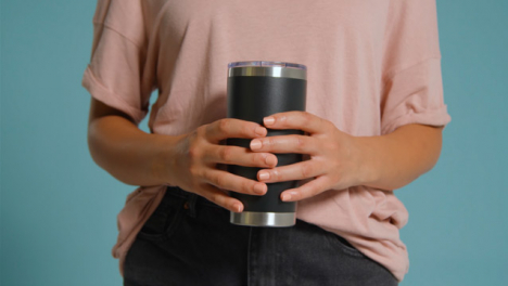 Close-Up-Shot-of-Young-Adult-Womans-Hands-Holding-Flask-01