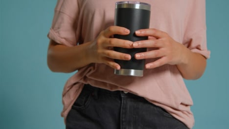 Close-Up-Shot-of-Young-Adult-Womans-Hands-Holding-Flask-02