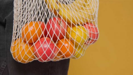 Close-Up-Shot-of-Young-Adult-Woman-Holding-Bag-of-Vegetables