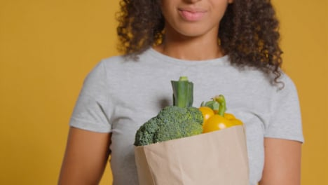 Portrait-Shot-of-Young-Adult-Woman-with-Brown-Paper-Bag-of-Vegetables-02