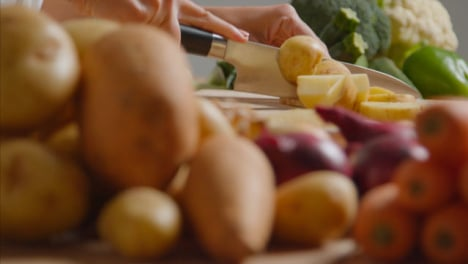 Tracking-Shot-of-Young-Adult-Woman-Slicing-Potato-01