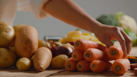 Tracking-Shot-of-Young-Adult-Woman-Slicing-Carrot