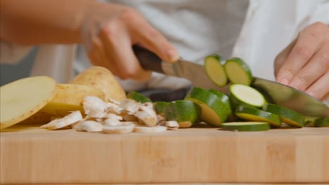 Tracking-Shot-of-Young-Adult-Woman-Slicing-Courgette-02