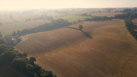 Drone-Shot-Rising-Above-Rural-Fields