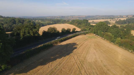 Drone-Shot-Panning-Up-Over-Rural-Fields