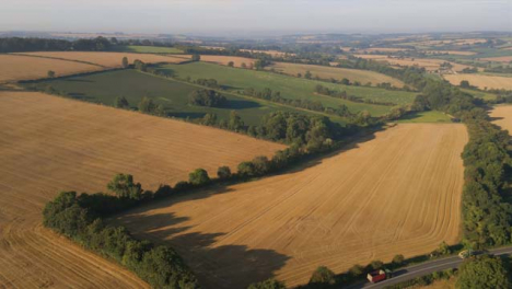 Drone-Shot-Flying-Away-from-Countryside-Fields