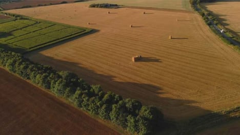 Drone-Shot-Flying-Over-Tractor-In-Rural-Field-