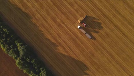 Drone-Shot-Looking-Down-On-Tractor-In-Rural-Field-