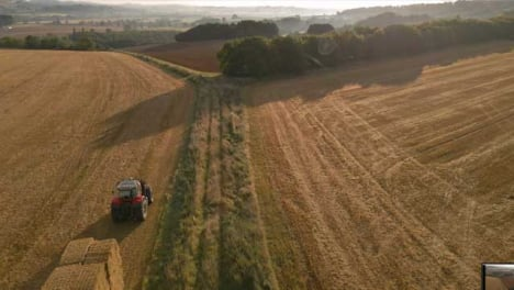 Drone-Shot-Rising-Above-Tractor-Working-In-Rural-Fields
