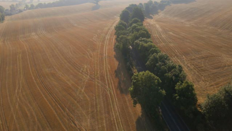 Drone-Shot-Panning-Up-Over-Some-Countryside-Fields