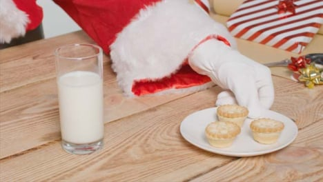 High-Angle-Shot-of-Santa-Pulling-Plate-of-Mince-Pies-to-Him