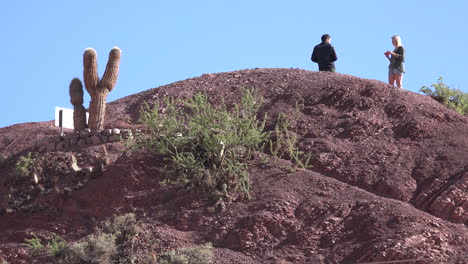 Argentina-Purmamarca-taking-pictures-on-hilltop