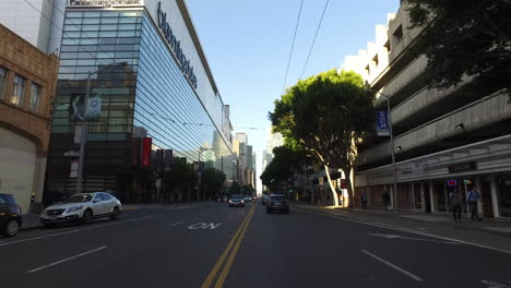 San-Francisco-California-passing-glass-building-and-cars