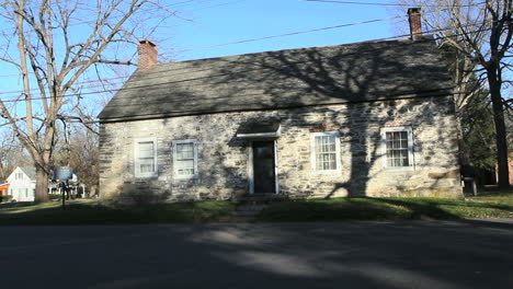 Trees-cast-shadows-on-the-stone-Freer-house-in-New-Paltz-