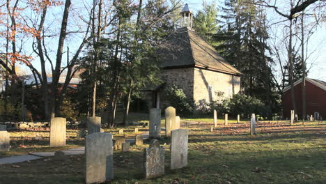 Tombstones-stand-in-a-cemetery-by-the-historic-Walloon-Church-in-New-Paltz-