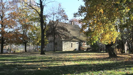 Trees-surround-an-old-stone-house-in-New-Paltz-