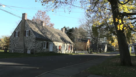 An-old-stone-house-stands-on-a-street-in-a-National-Historic-Landmark-