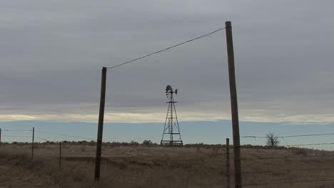 Oklahoma-windmill-seen-through-fence
