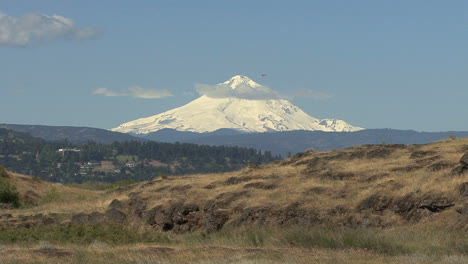 Oregon-Mount-Hood-and-small-plane-flying-by