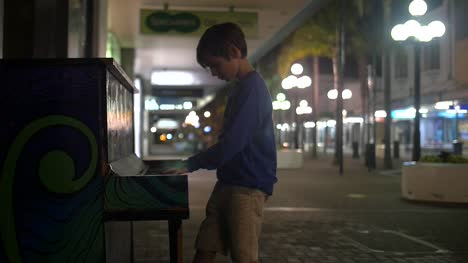 Young-Boy-Playing-Piano-in-the-Street-2