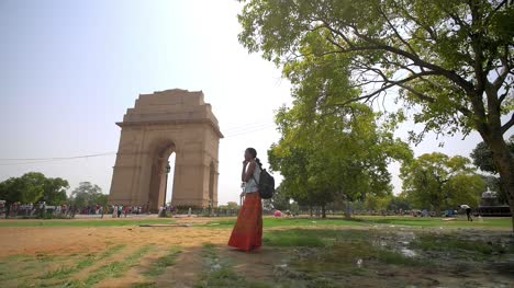 Woman-Using-Phone-at-India-Gate