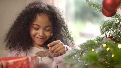 Happy-Child-Holding-Unopened-Present