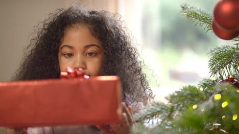 Inquisitive-Child-Holding-Christmas-Present