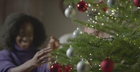 Couple-Decorating-Christmas-Tree-2