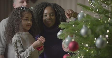 Family-Decorating-Christmas-Tree-1