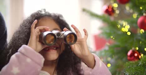 Child-Playing-with-Binoculars-at-Christmas-1