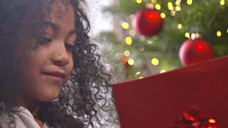 Girl-Examining-Christmas-Present