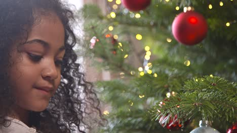 Young-Girl-By-Christmas-Tree