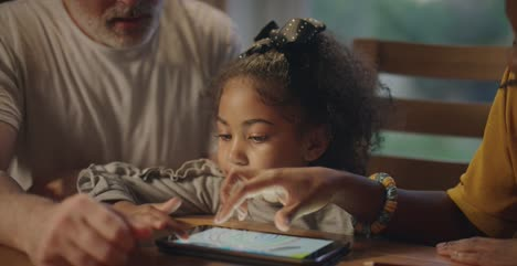 Parents-and-Child-Using-a-Tablet
