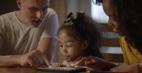 Child-and-Parents-Using-a-Tablet