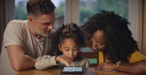 Parents-and-Child-Learning-With-Tablet