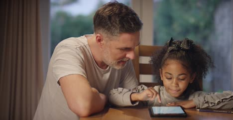 Father-and-Child-Using-a-Tablet