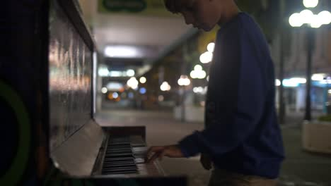 Young-Boy-Plays-Piano-in-Street