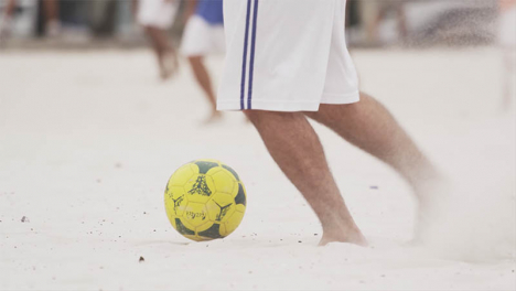 Playing-Beach-Football-02