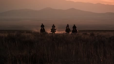 Cattlemen-Riding-Horses-at-Sunset-02