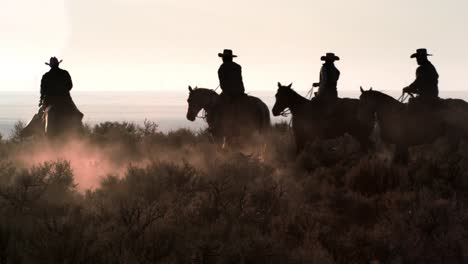 Cattlemen-Riding-Horses-at-Sunset-04