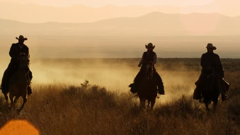 Cattlemen-Riding-Horses-at-Sunset-06